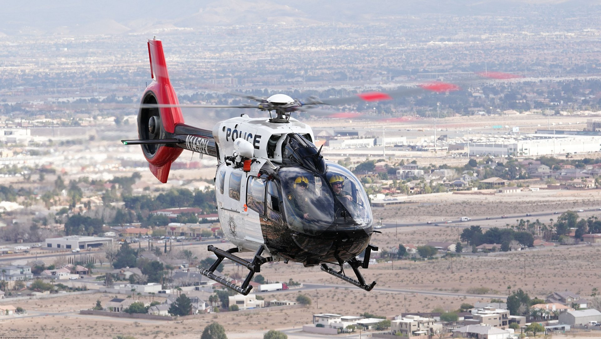 The crew of the Las Vegas Metropolitan Police Department鈥檚 air unit in an H145 helicopter. AG真人计划 has more than 800 helicopters in service in law enforcement with the H125, H135 and H145, contributing to AG真人计划鈥� nearly 60 percent share of the global law enforcement fleet over the last 10 years.