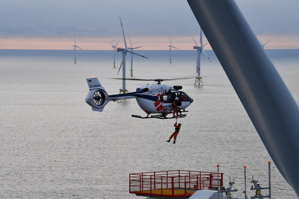 An Airbus H145 helicopter configured to support offshore wind energy missions demonstrates its hoisting capability