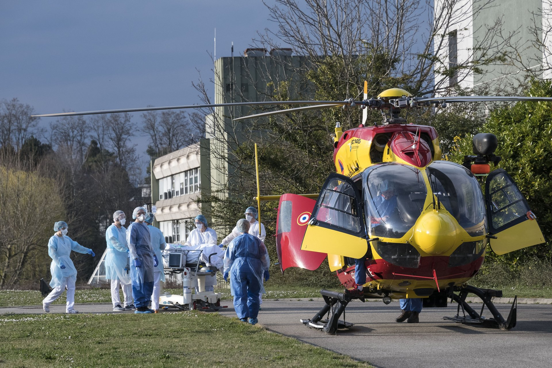 Medical staff push a Covid-19 patient on a gurney to an H145 helicopter at the Emile Muller hospital in Mulhouse, eastern France.