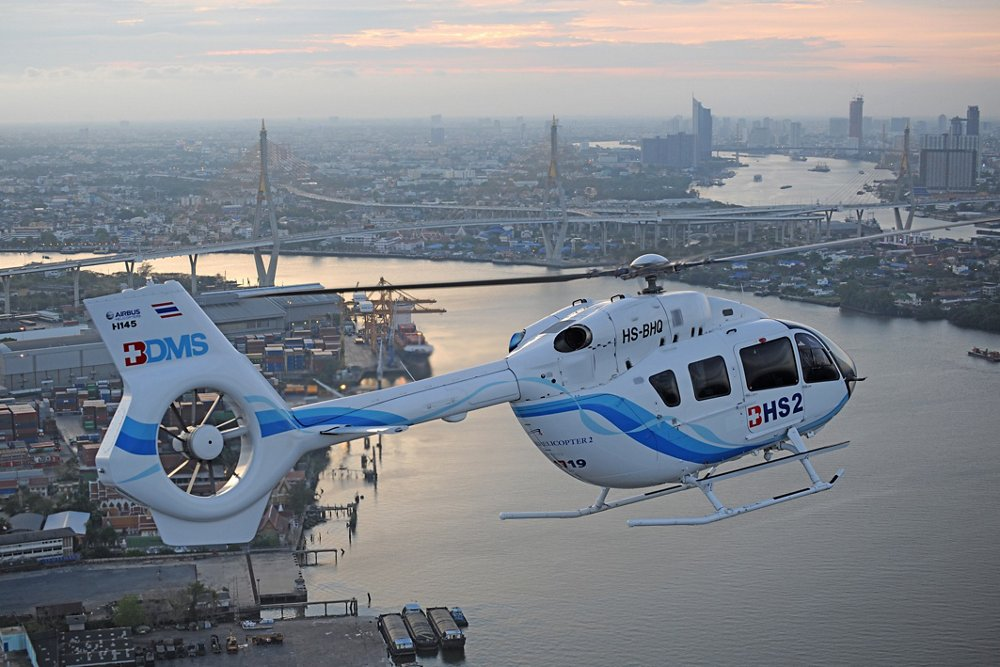 An H145 rotorcraft operated by Thailand's Bangkok Helicopter Services is shown in flight.