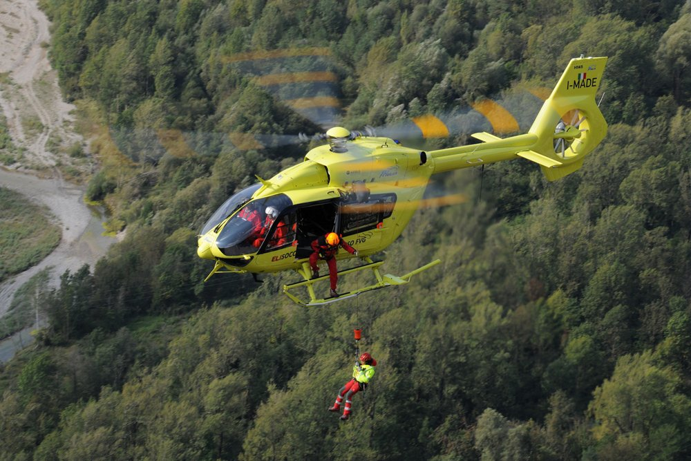 An Airbus-built Elifriulia H145 helicopter winches a person during HEMS (Helicopter Emergency Medical Services) training.