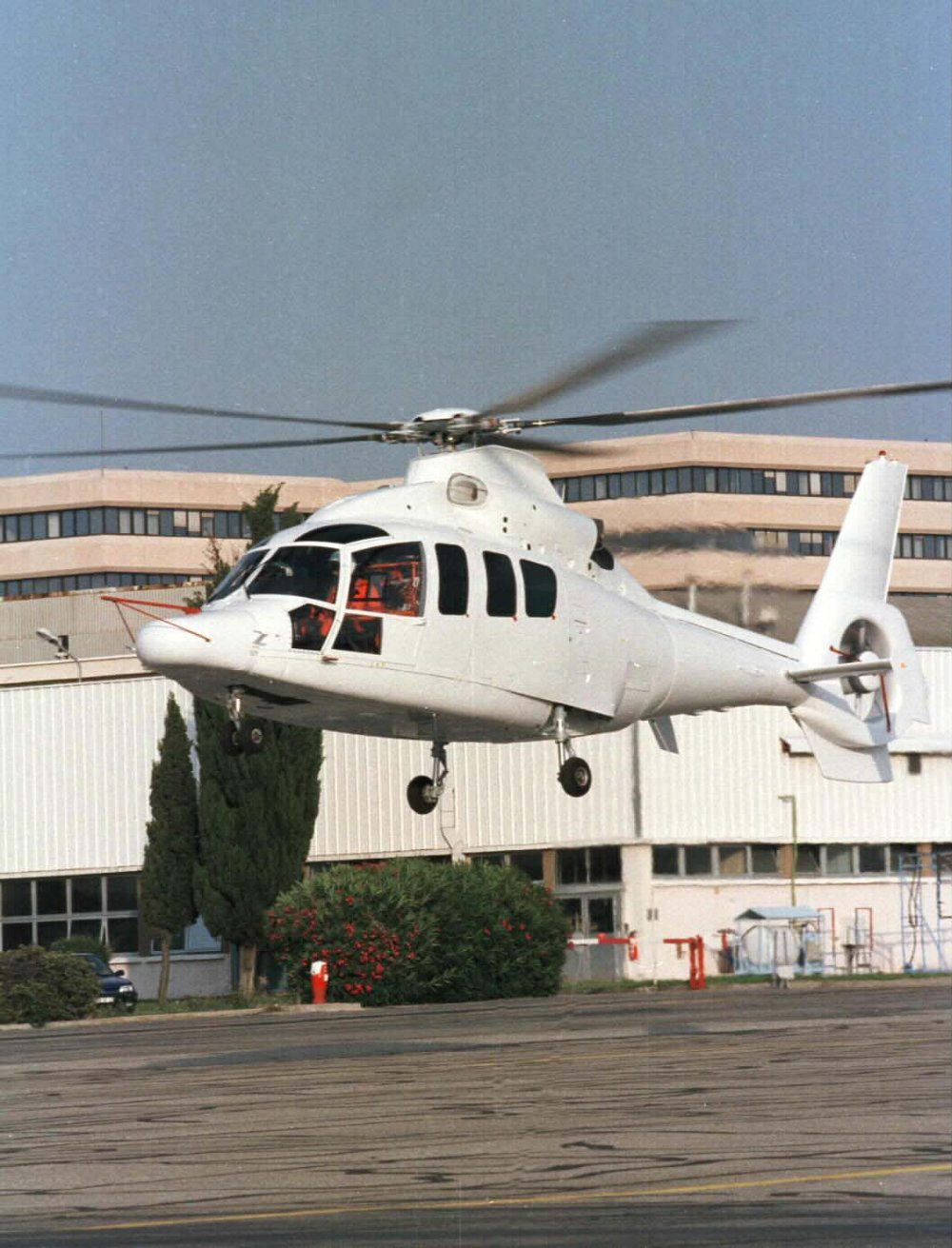 Airbus' twin-engine H155 in white livery landing