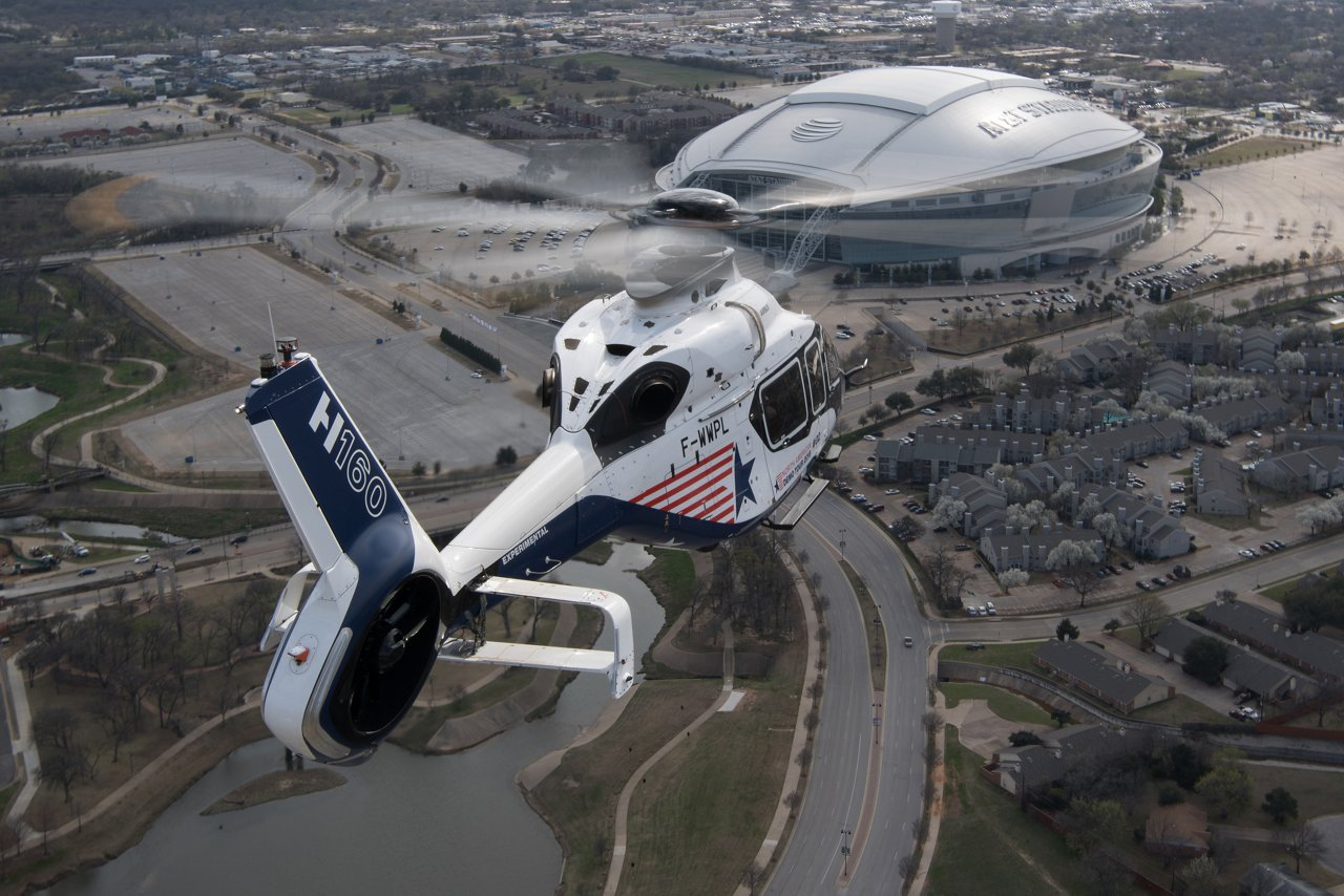 The Airbus H160 prototype flies toward AT&T Stadium, home of the National Football League's Dallas Cowboys, while on a demonstration tour across North America