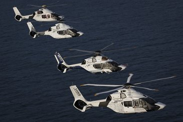 Four H160s in flight
