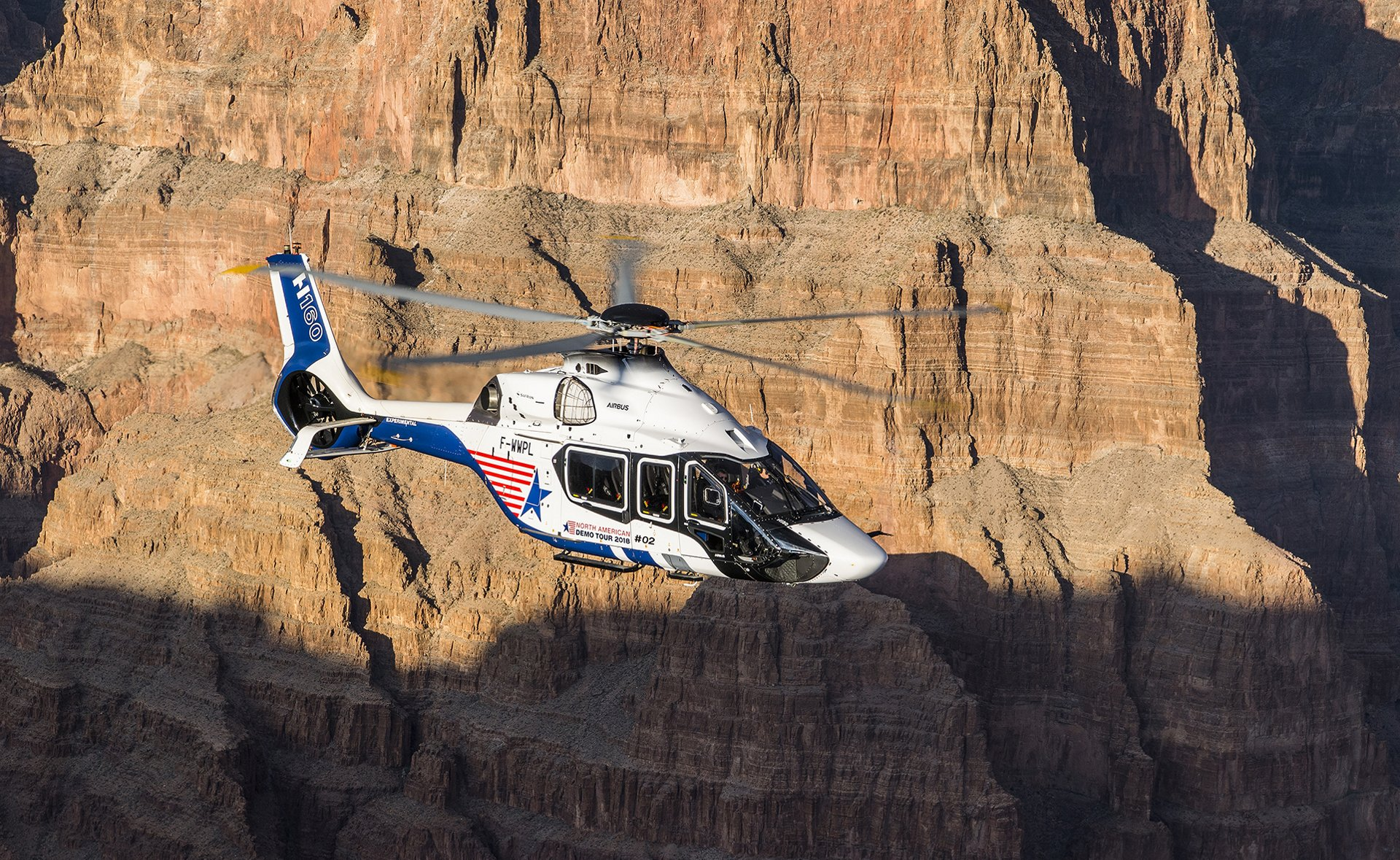 The H160 flies over the Grand Canyon just before its international airshow debut at the 2018 HAI-Heli-Expo in Las Vegas, Nevada