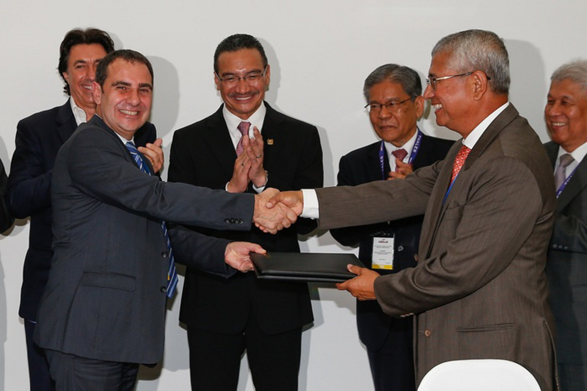 Airbus Helicopters Malaysia and Boustead Heavy Industries Corporation seal joint venture agreement at LIMA 2015 for regional helicopter simulation center