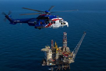 Bristow's H225 flying above an offshore oil rig