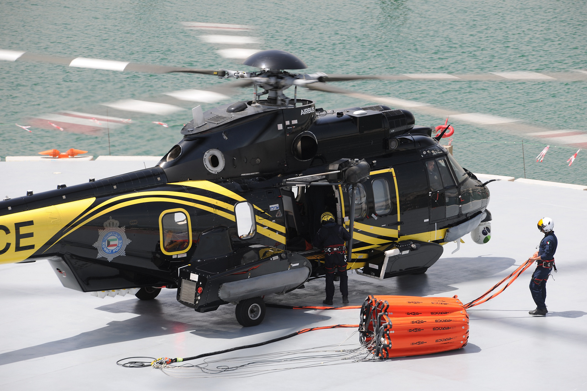 A bucket-type water dispersal system is readied for use on one of the Kuwait Ministry of Interior's H225 helicopters.