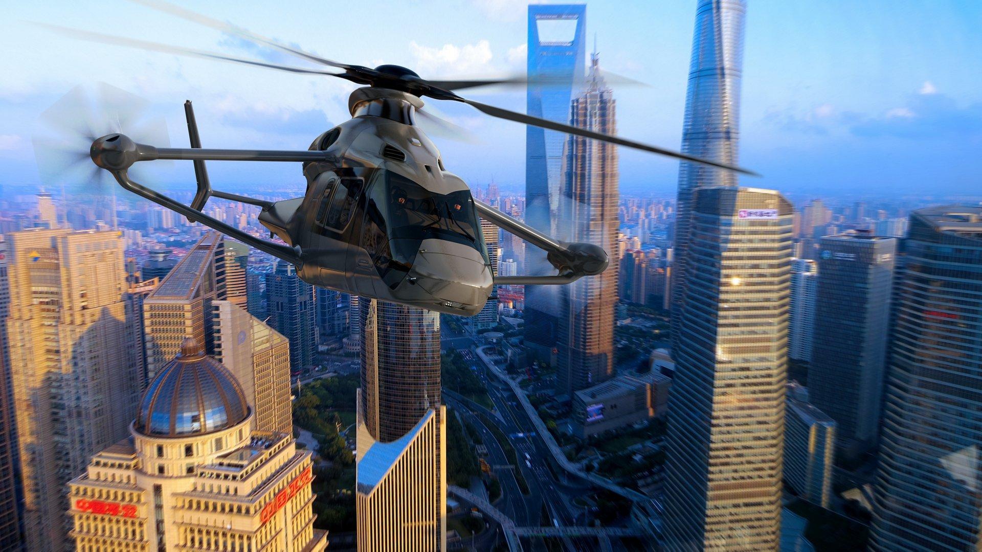 The Racer high-speed VTOL helicopter demonstrator is depicted in flight.