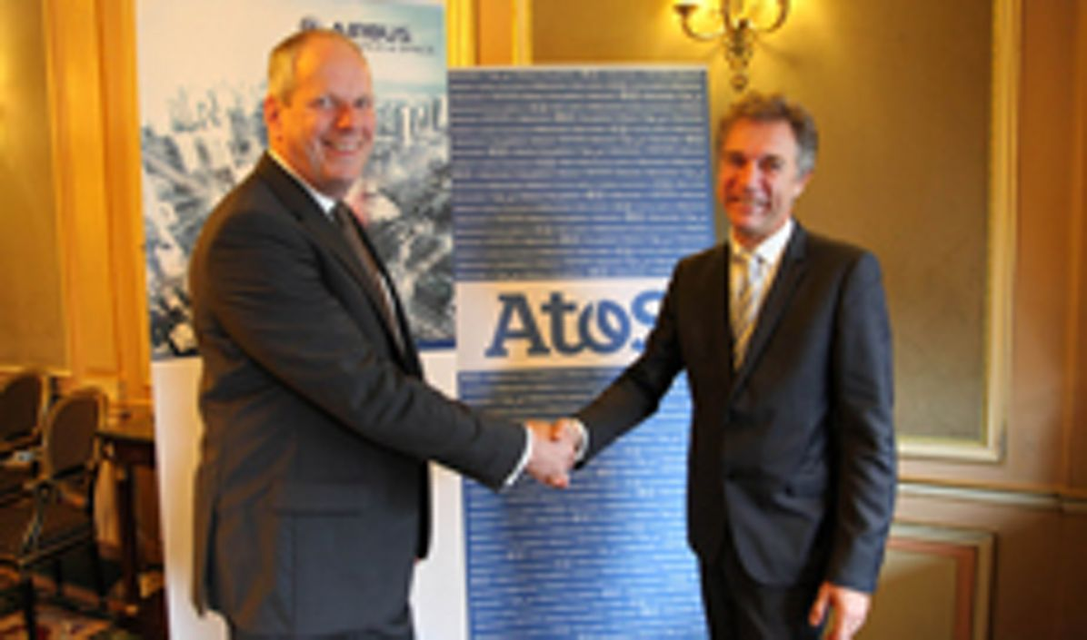Evert Dudok from Airbus and Philippe Vannier from ATOS sign a strategic agreement in the field of cyber security