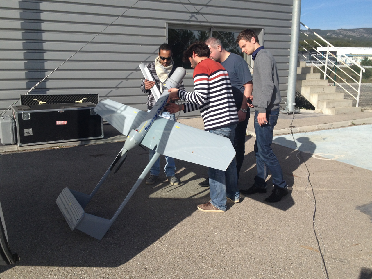 An unmanned aerial vehicle (UAV) is examined before flight.