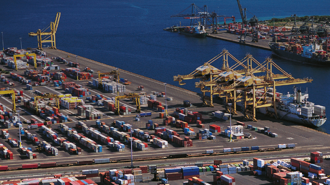 A busy port area with many shipping containers.