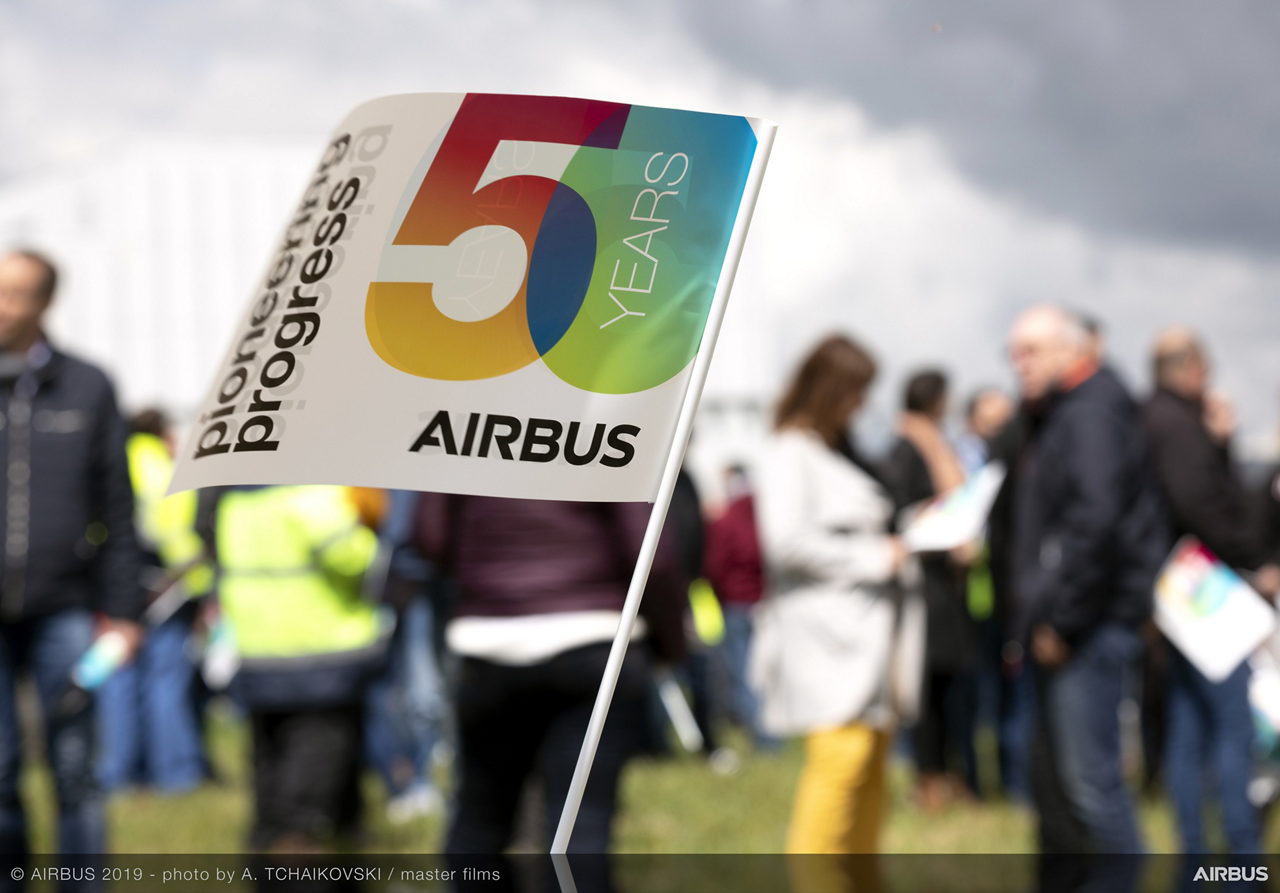 "The Airbus family formation flight – performed in celebration of the company's 50th anniversary – attracted a large audience in the ""fan zone"""