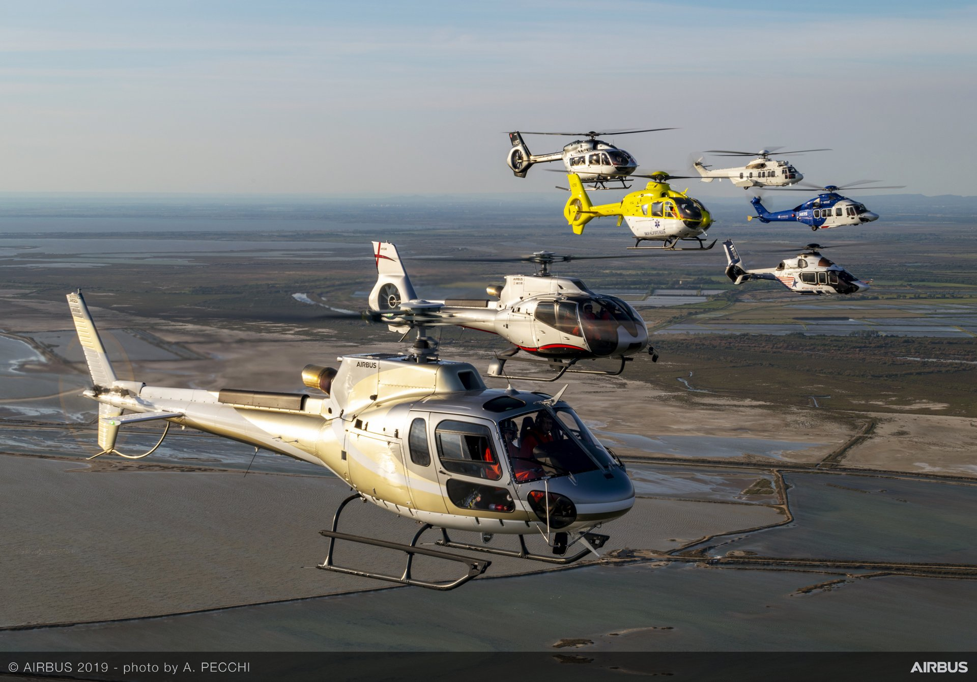 Airbus' product line of civil helicopters – from the single- and twin-engine light category to medium and eleven-ton-class rotorcraft – is shown in formation flight celebrating Airbus' 50th anniversary, composed of the H125, H130, H135, H145, H160, H175 and H225