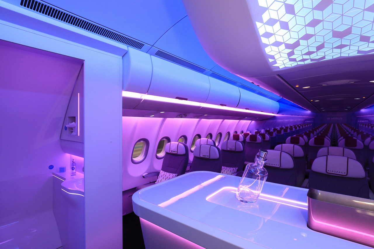 A look inside an A330neo Airspace cabin with custom lighting scenarios