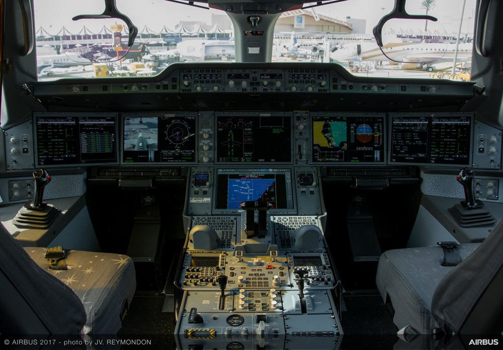 Visitors to Airbus' no. 2 Airbus A350-900 development aircraft during Dubai Airshow 2017 experience the aircraft's state-of-the-art cockpit, featuring six very large liquid crystal display (LCD) screens that provide ample room to show all the flight and system information needed for travel in the global airspace of today and tomorrow
