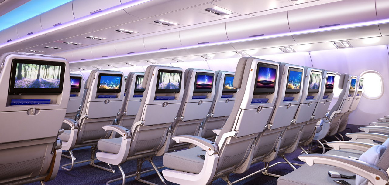 Rows of passenger seating with integrated in-flight entertainment systems