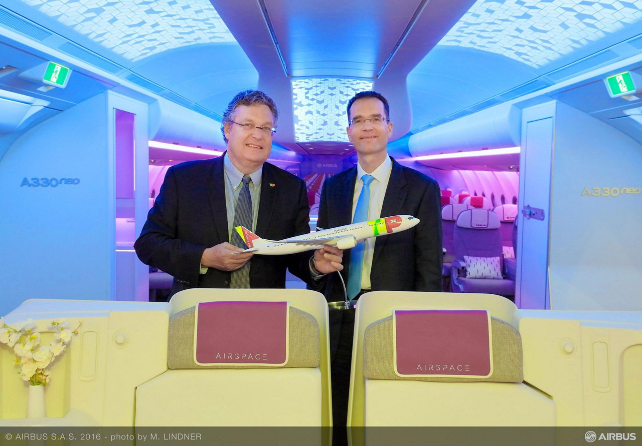 "Trey Urbahn, Chief Commercial Officer at TAP Portugal (at left): ""We are extremely proud to be the first airline to fly the Airspace by Airbus cabin in the new A330neo."" Joining him in the photo is Francois Caudron, SVP Marketing Airbus"