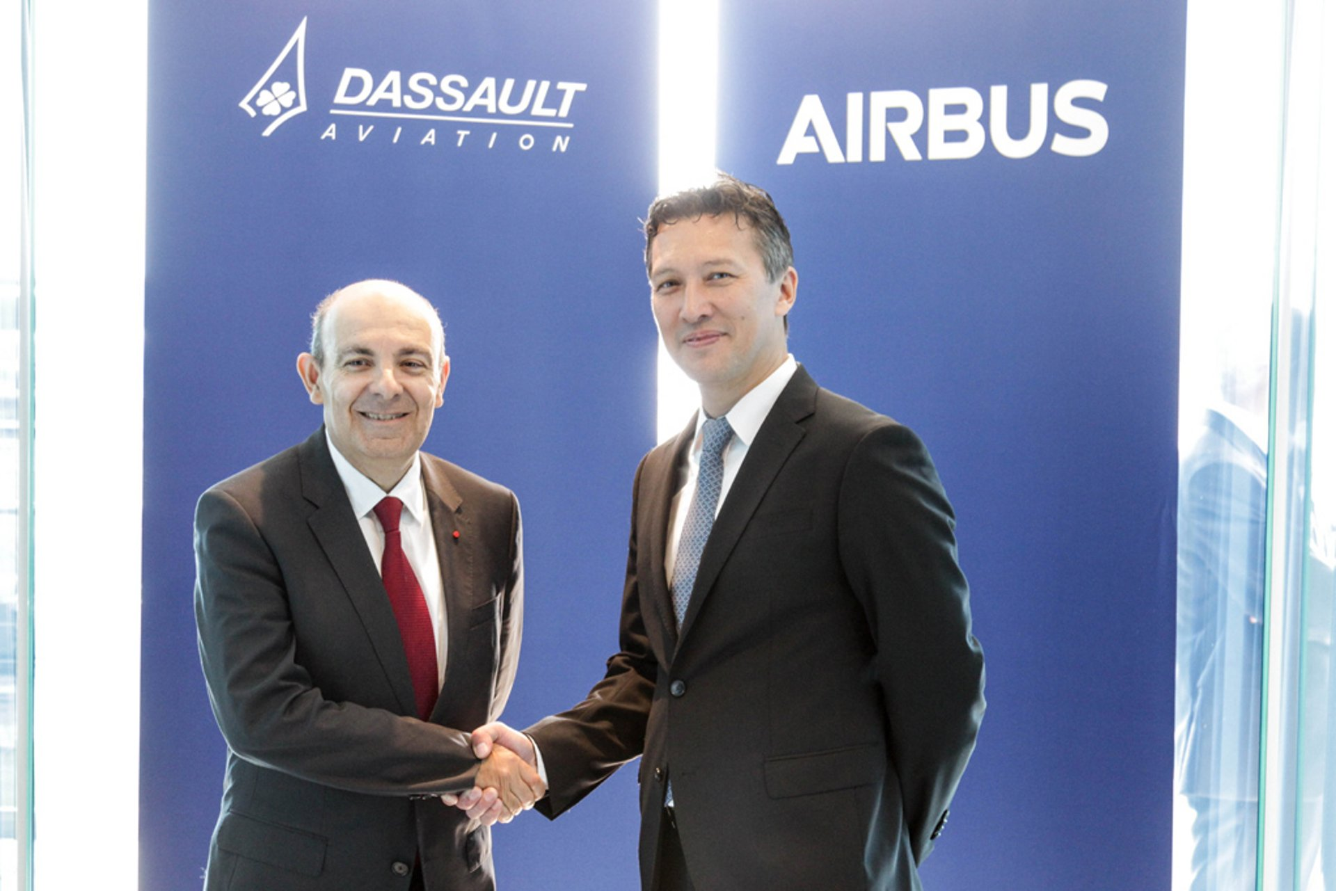 Airbus and Dassault Aviation have decided to join forces for the development and production of Europe's Future Combat Air System (FCAS); marking the collaboration with a handshake at the 2018 ILA Berlin air show are (from left to right): Éric Trappier, CEO of Dassault Aviation, and Dirk Hoke, CEO of Airbus Defence and Space