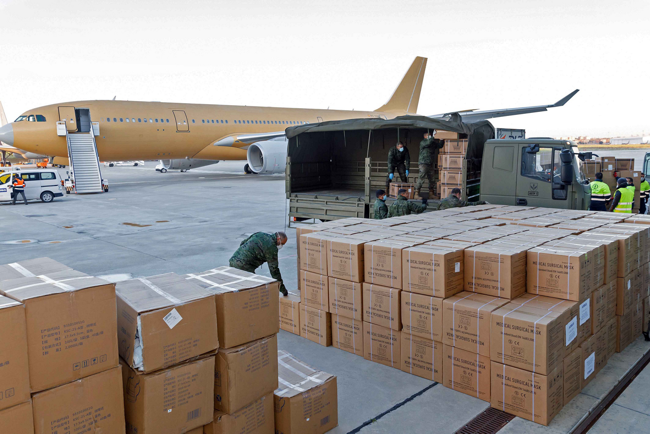 Boxes of protective face masks and other medical supplies are unloaded from an A330-200 after completing a March 2020 supply flight from Tianjin, China – which was operated by a crew from the military aircraft operation of Airbus Defence and Space in Spain