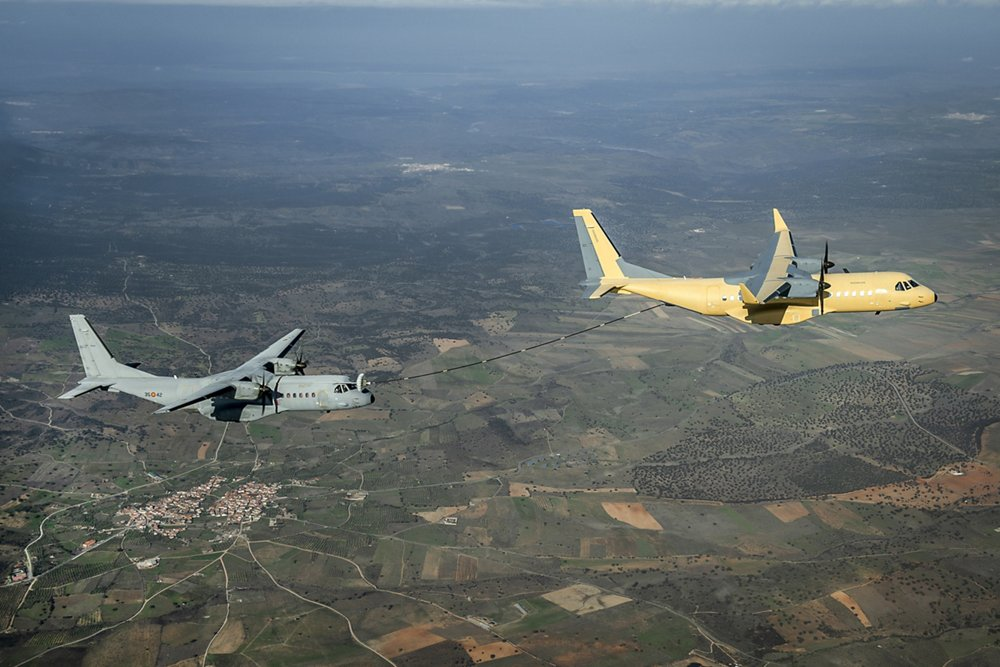 Two Airbus C295 transport aircraft are shown during air-to-air refuelling evaluations.