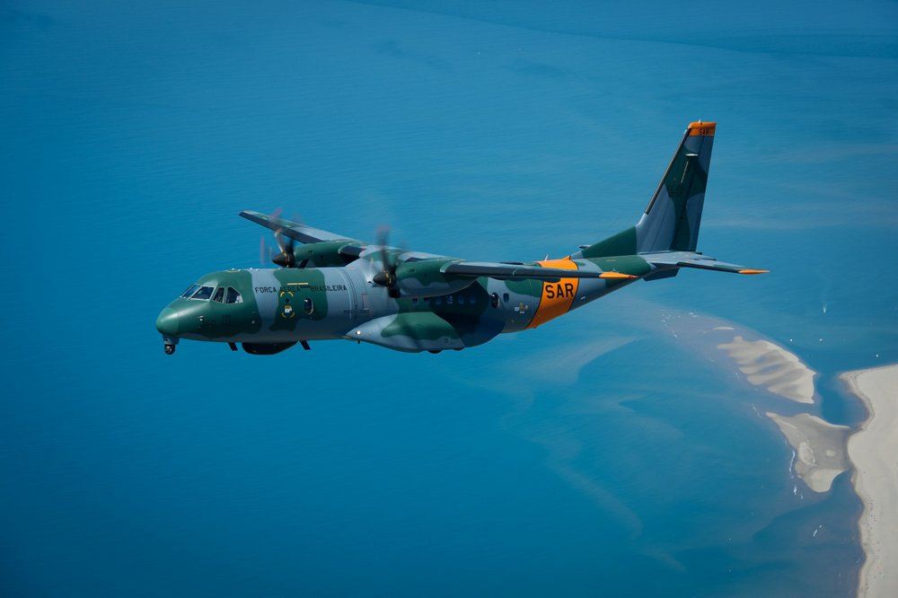 The Brazilian Armed Forces' first C295 configured for search and rescue (SAR) operations is shown in flight.