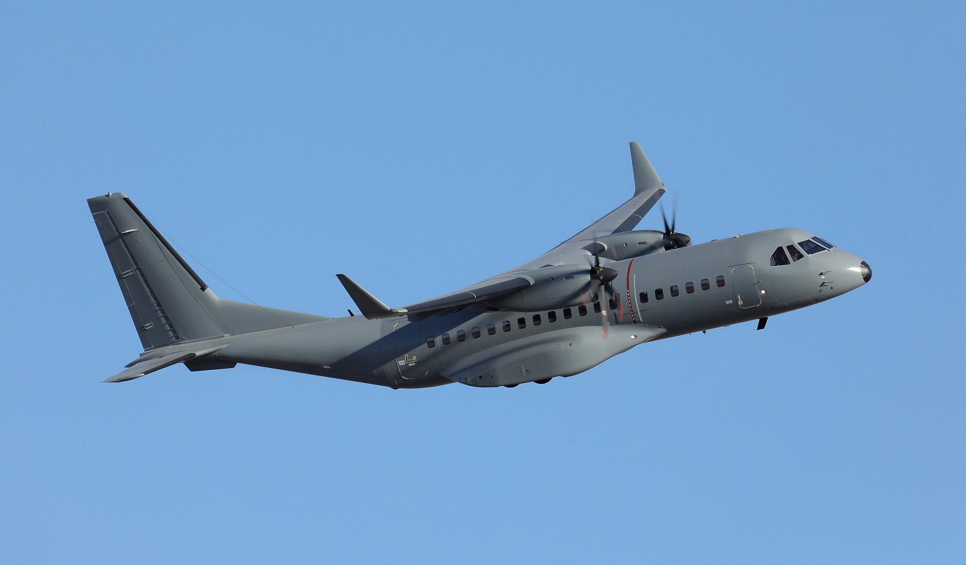 A C295 in-flight during a military mission.