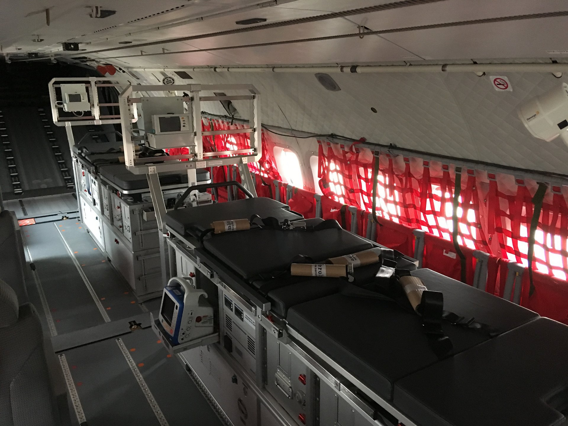 A view inside a medevac-configured Airbus C295 cabin, including stretchers and other medical equipment.