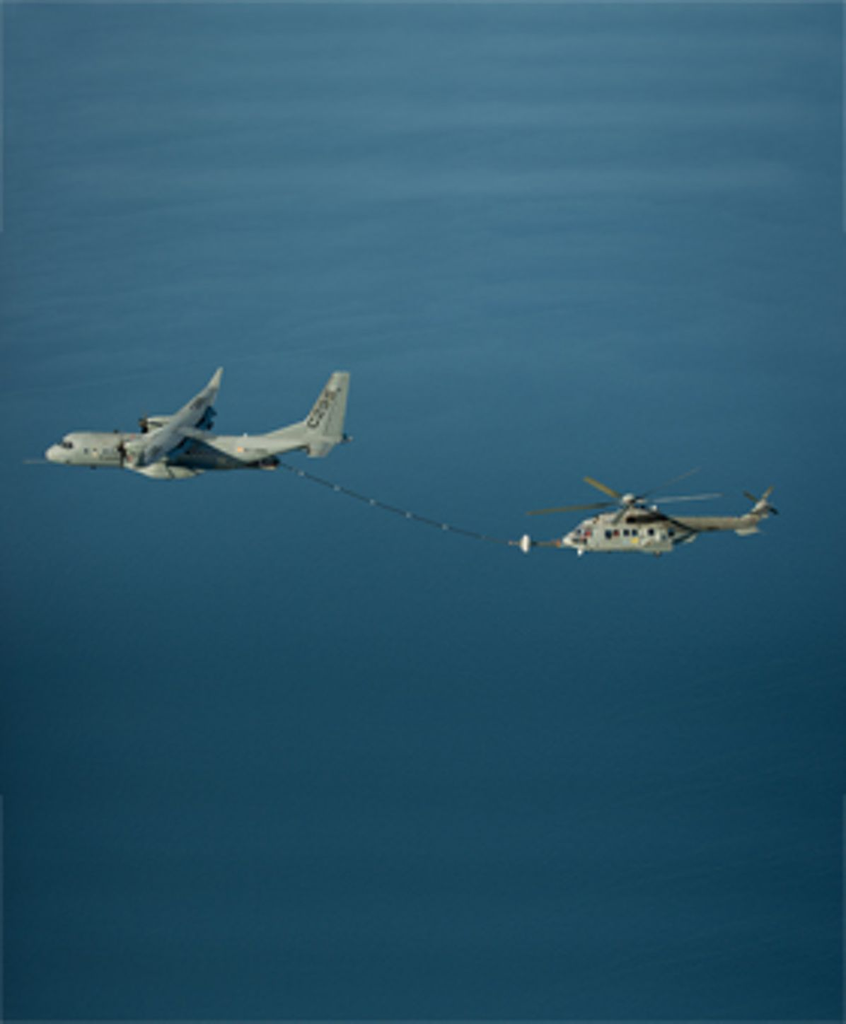 Air-to-air refuelling between  C295W medium transports with a H225M Caracal helicopter