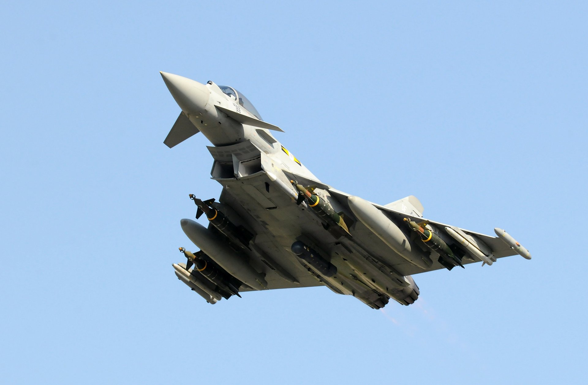 Representation of a Eurofighter Typhoon swing-role fighter aircraft in flight.