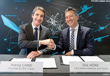 Signature by D. Hoke and Thales CEO Patrice Caine