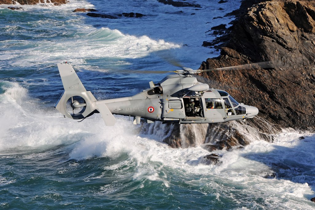 Side view of an AS565 MBe flying above the sea