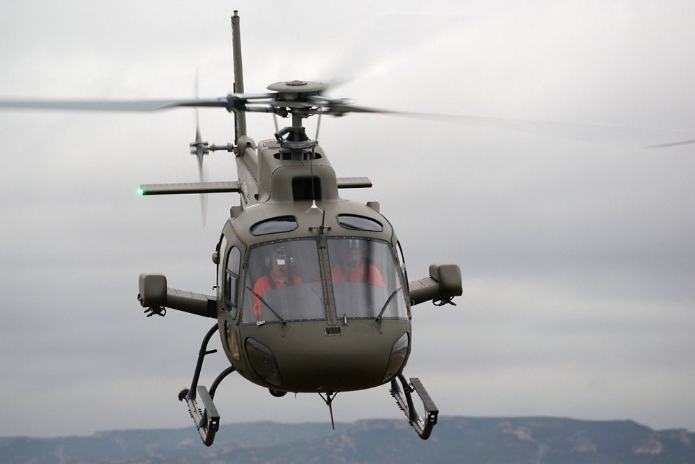 Head-on view of an in-flight Airbus H125M military helicopter.