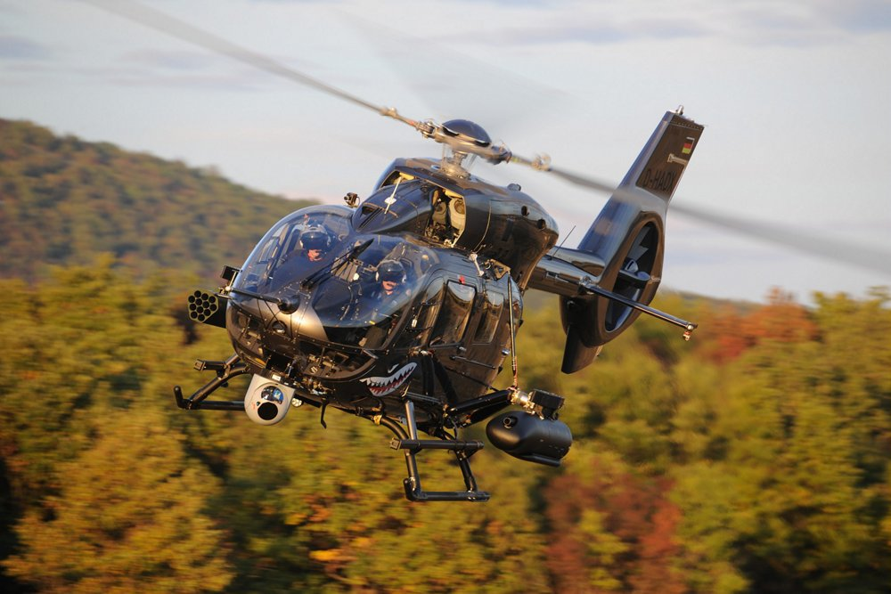 View of an in-flight H145M military helicopter equipped with the Airbus-designed HForce weapon system.