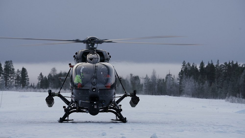 An on-ground, head-on photo of an Airbus H145M military helicopter with HForce weapon system.