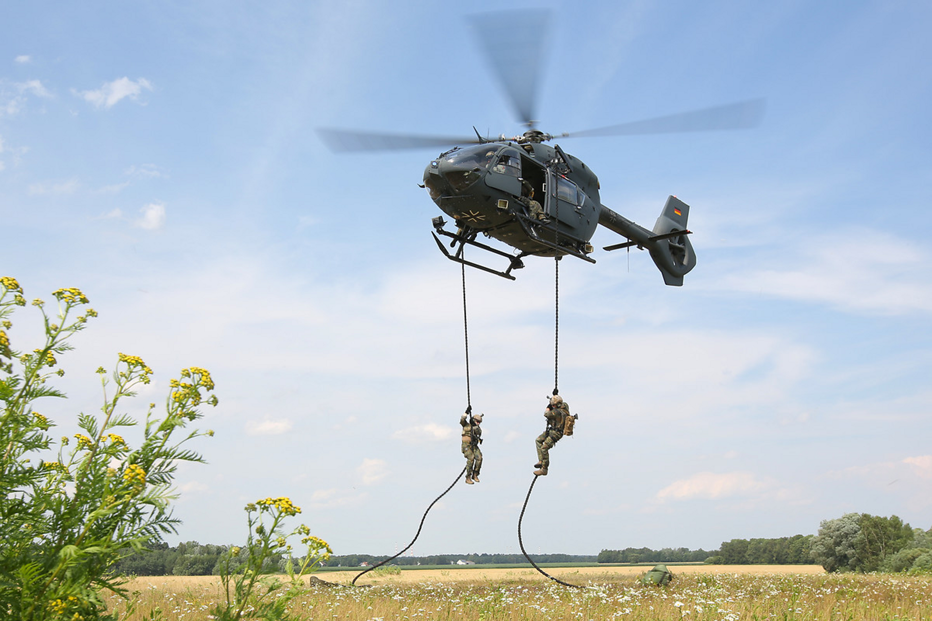 Military personnel rappel from an H145M operated by Germany.