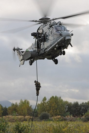 Troops winching down from an H225M Caracal