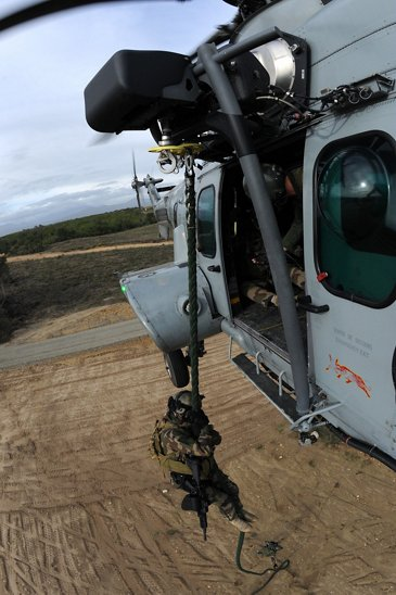 Soldier winching down from an H225M Caracal