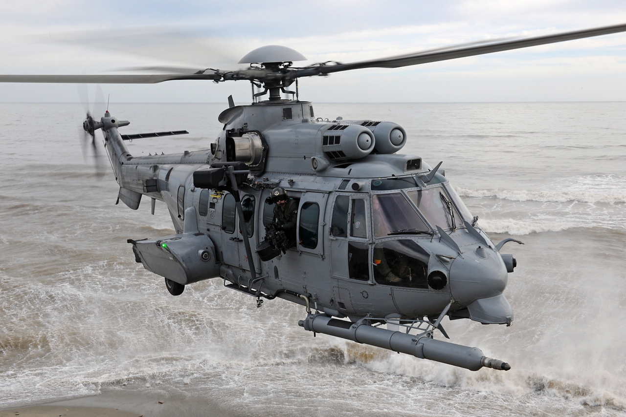 An up-close view of an in-flight EC725 military helicopter (later re-designated the H225M).