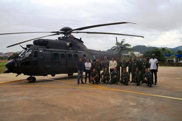 The Brazilian Armed Forces next to the first H225M delivered