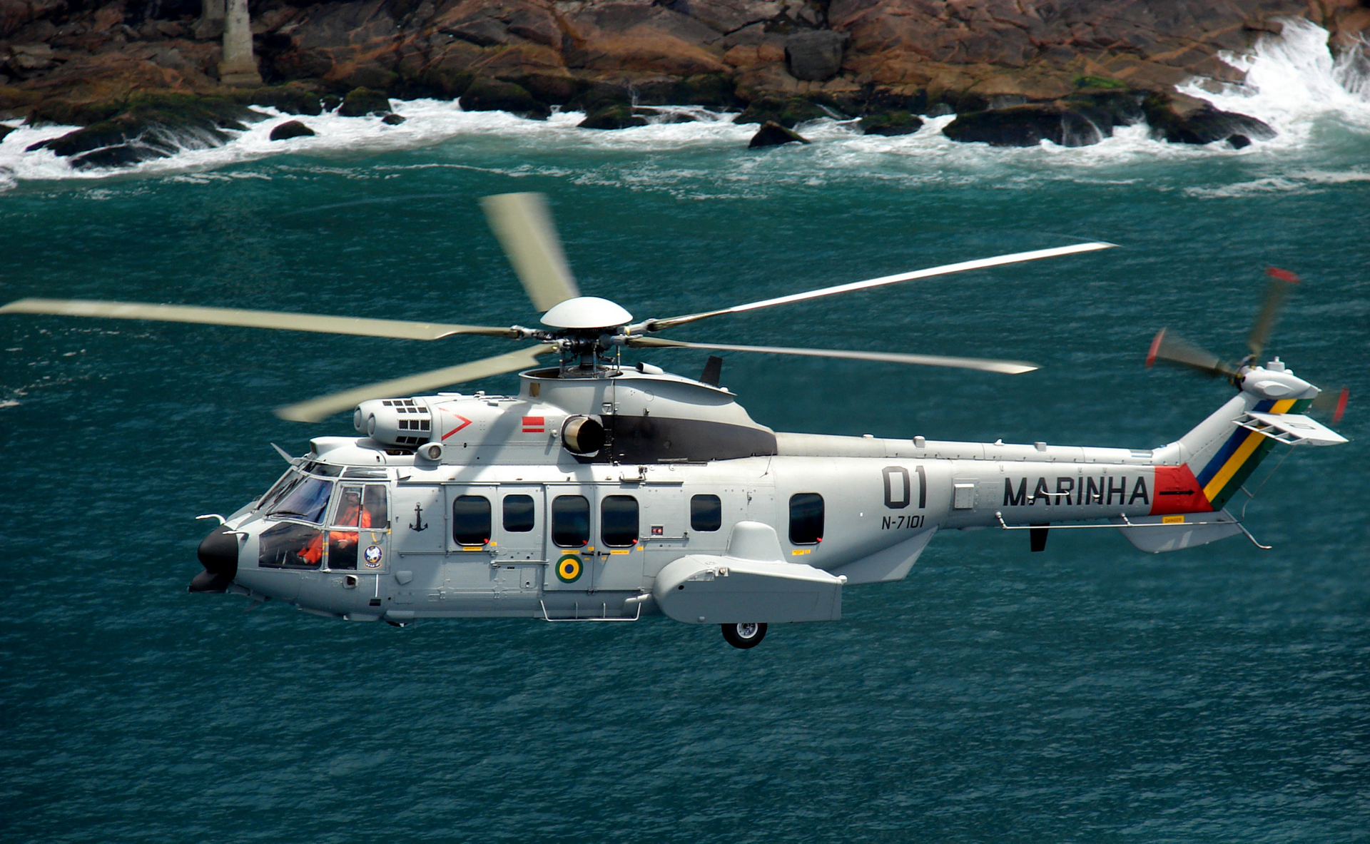 An H225M rotorcraft is showing flying over a coastal area.