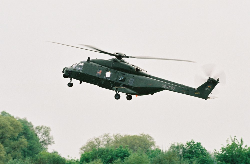 The side view of an in-flight TTH German army variant of the Airbus-produced NH90 helicopter.