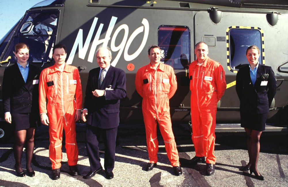 Team members who performed the first official flight of an NH90 helicopter in 1996 mark the occasion with government representatives.