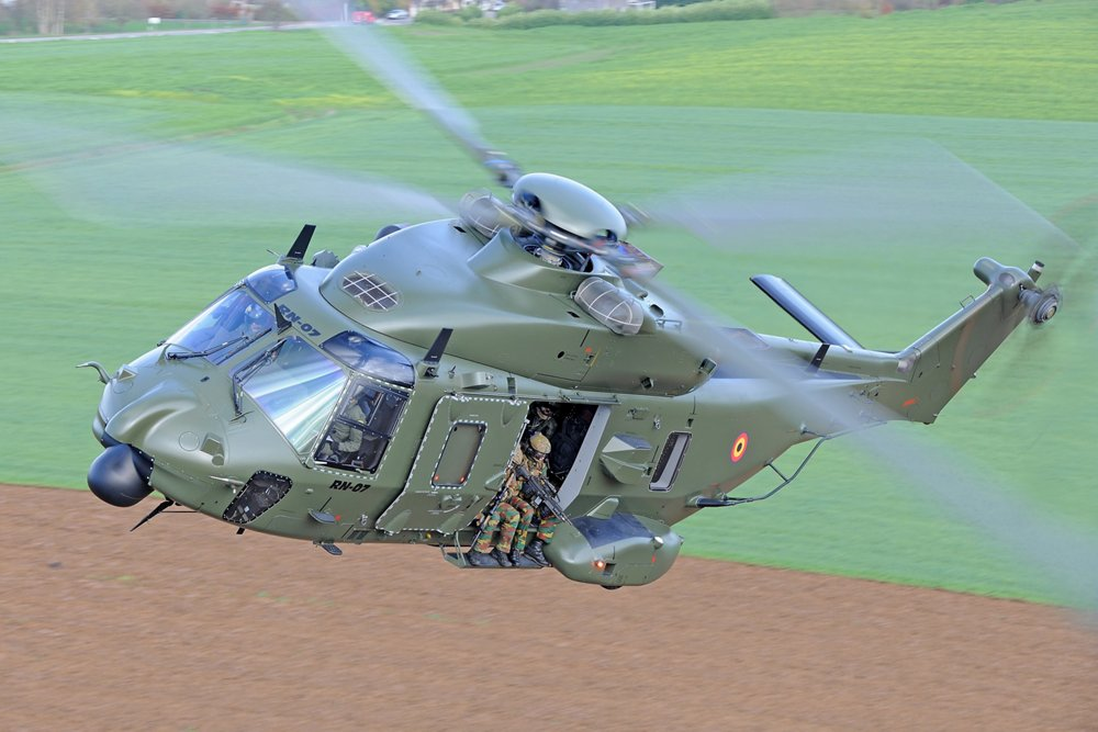 Belgian Air Component's NH90 TTH in flight above fields