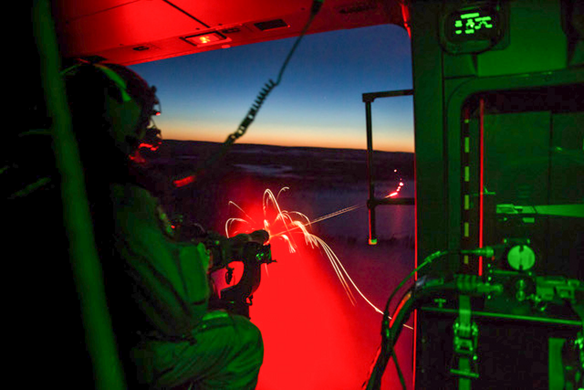 Inside view of Finnish Defence Forces NH90 during live firing exercise.