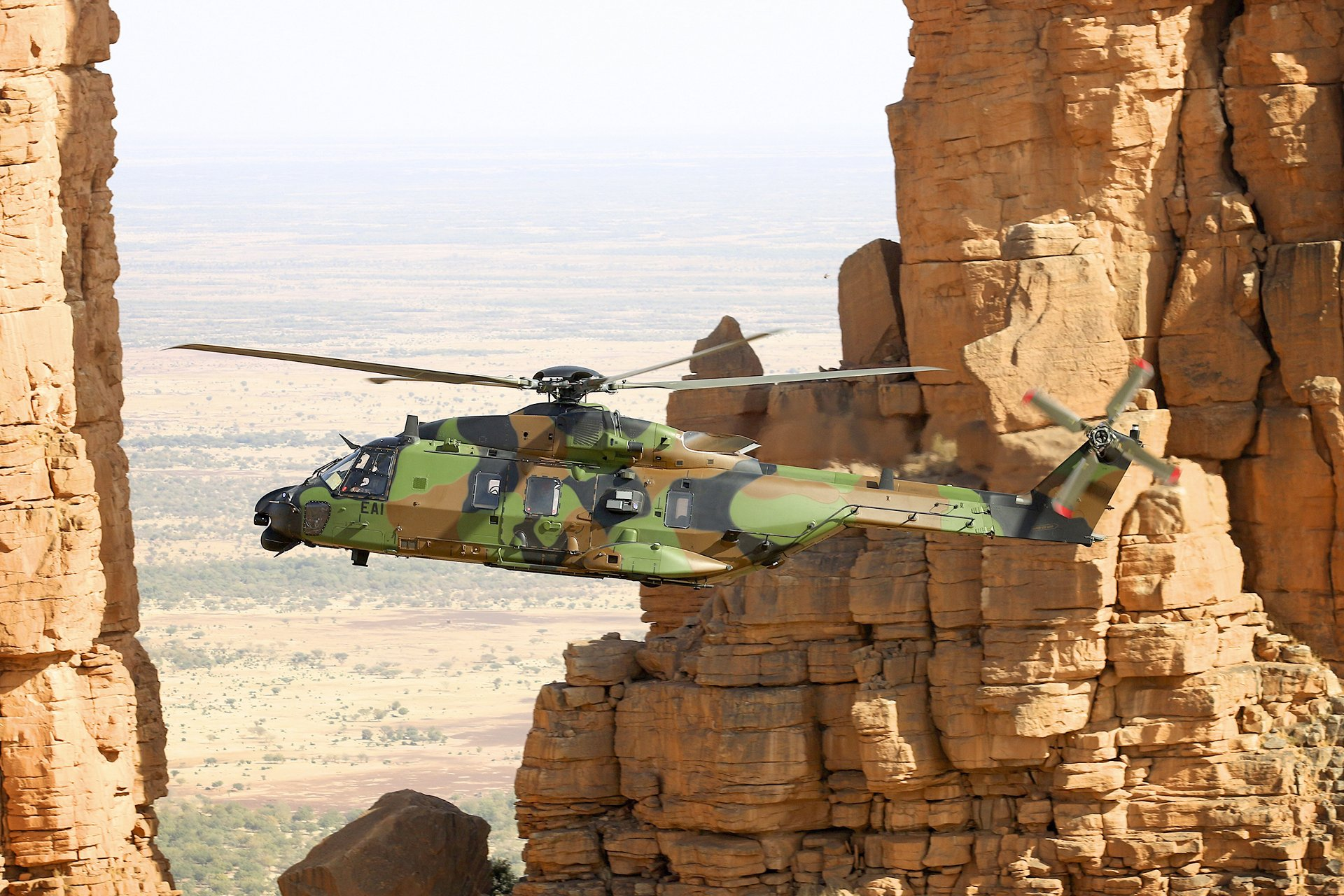 An NH90 operated by the 1st Combat Helicopter Regiment (RHC) of the French Army Light Aviation (ALAT) unit is shown in flight.