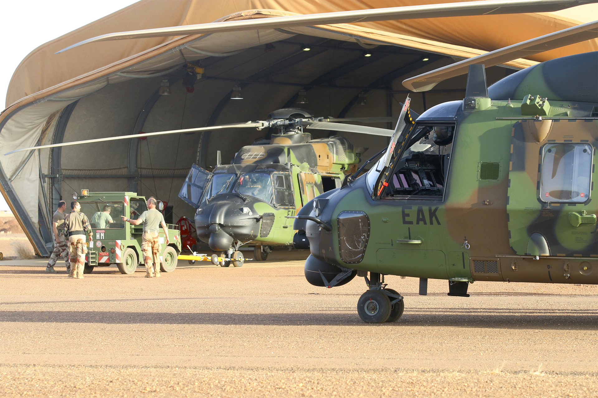 An NH90 helicopter is shown in the Sahel area.