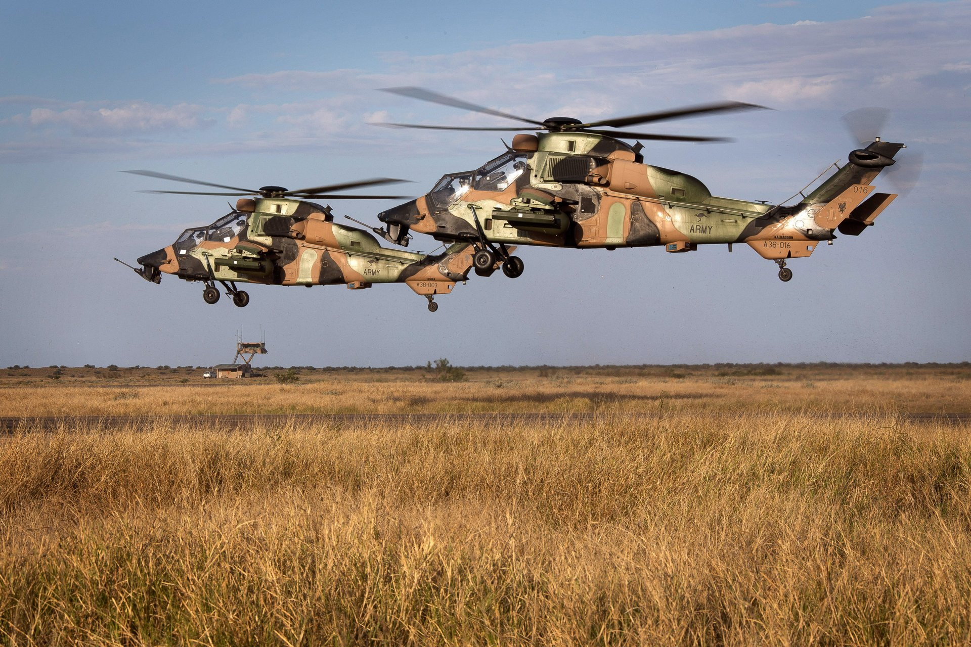 Tiger Armed Reconnaissance Helicopters land at RAAF Learmonth after conducting security operations during an Exercise Northern Shield scenario. *** Local Caption *** Tiger Armed Reconnaissance Helicopters (ARH) have arrived in Exmouth, Western Australia on Exercise Northern Shield to assist the Ready Combat Team (RCT) conduct security operations in the region.