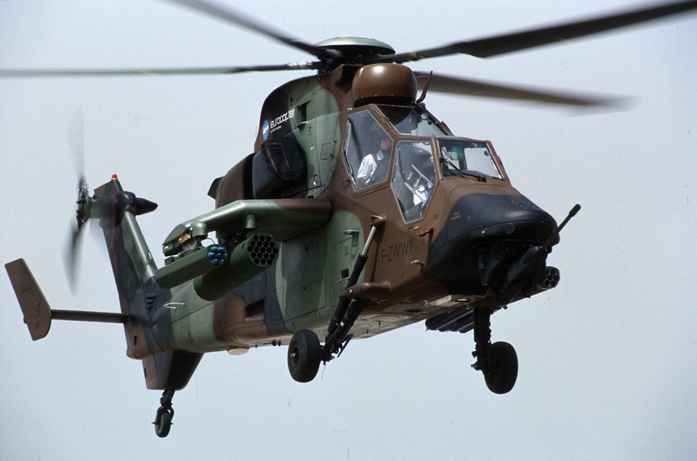 The front and side view of an in-flight, Airbus-built ARH Tiger military helicopter delivered to the Australian Army.