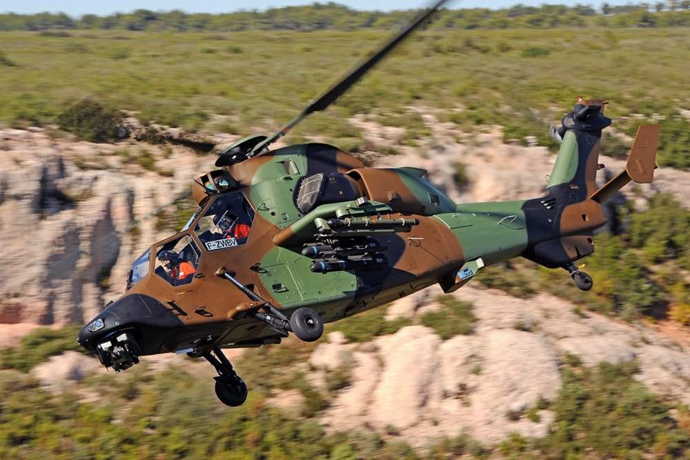 A Tiger helicopter in the HAD attack configuration is shown in flight.